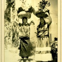 Women with gourd baskets
